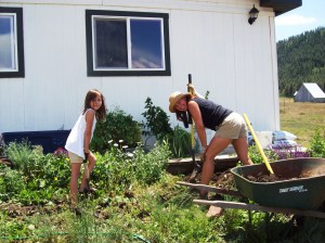 Sierra and I transplanting flowers and shrubs.