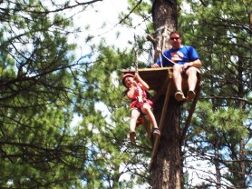 Sierra, fearless on the zip-line at Girl Scout camp.